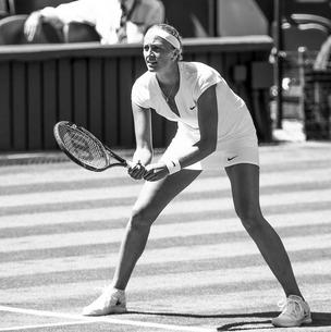 Petra Kvitova in Wimbledon whites by Nike Court with a streamline cut neckline