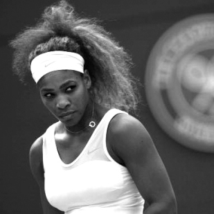 Serena Williams sets sights on her target, ready to strike in a tiger patterned translucent midriff dress by Nike Court